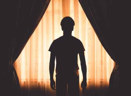 art back view backlit boy